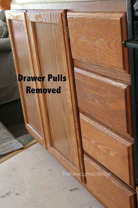 cabinet-drawer-pulls-removed-prior-to-painting